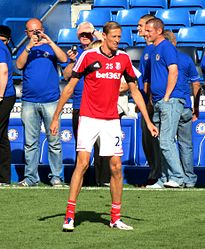 "Peter Crouch, an example of a ""lean and muscular"" men's association football player"