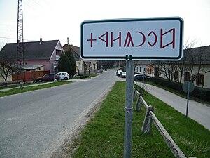 Csongrád - Rovas city limit sign near the pontoon bridge, featuring Hungarian runes.