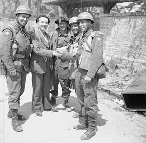 Beach groups - Military Police dispatch riders of No.5 or 6 Beach group greet French Civilians