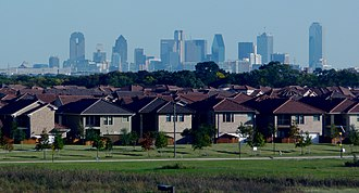 Suburban Dallas, Texas seen in the foreground Dallas skyline and suburbs.jpg