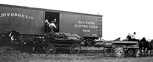 History of Richfield, Minnesota - Bachman farmstead workers load produce onto a Dan Patch line boxcar for delivery to market.