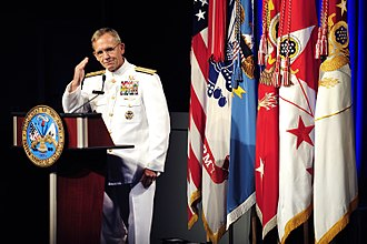 Medal of Honor - Admiral Eric T. Olson salutes Sergeant First Class Leroy Petry at a ceremony at The Pentagon.