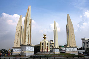 Thailand - Bangkok's Democracy Monument: a representation of the 1932 Constitution sits on top of two golden offering bowls above a turret.