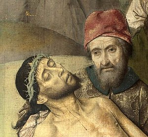 The Entombment (Bouts) - Detail showing Nicodemus supporting the lifeless body of Christ. Loss of pigment is visible in areas of Nicodemus' headdress.