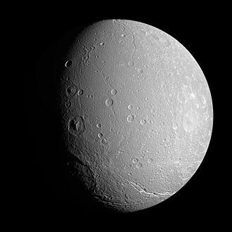 Dione (moon) - ''Cassini'' view of Dione's leading hemisphere. The large craters on or near the terminator are (from bottom to top) Evander, Erulus, Lagus and Sagaris. The Palatine Chasmata fractures stretch across the lower right limb, and the trough Aufidus Catena extends along the bottom near the south pole.