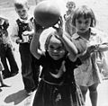 Dorothea Lange, Migrant children playing at nursery school, FSA camp, Tulare County, California, 1939.jpg