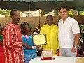 Dr. Ariel Pablos-Mendez presents award to Community Health Worker (6096140365).jpg