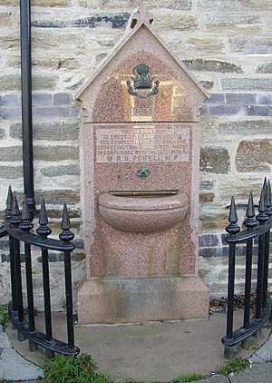 "Walter Rice Howell Powell - Powell is still remembered in Llanboidy by the drinking fountain inscribed ""This fountain is erected to commemorate the completion of the work for supplying this village with water in compliance with the last wish of W. R. H. Powell M.P."""