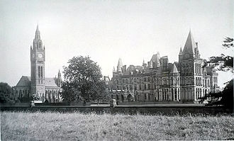 Eaton Hall, Cheshire - The entrance front of the Waterhouse Hall about 1907 showing the main block on the right and the chapel on the left, photographed by John Steggall