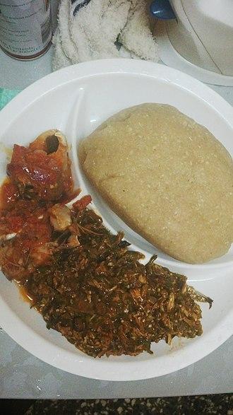 Eba - Eba and Efo riro (Vegetable Soup) with Fish
