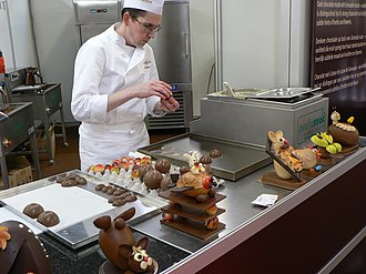 Chocolatier - A chocolatier making chocolate eggs of half eggs