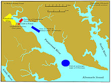 The Pasquotank River flows from the upper left corner to the bottom of the chart, entering Albemarle Sound about one-third of the chart width from the right edge. The outline of Elizabeth City is on the western side of the river, one-fourth of the chart height from the top. The river broadens from one mile near the city to three miles where it meets the sound, 15 mi (24 km) downstream. The Confederate defenses are a battery at Cobb's Point, near the southeastern edge of the city, and a line of ships stretching across the river from that point to the northeast. The Federal fleet is shown twice: its anchorage near the mouth of the river on 9 February, and the attacking column of 10 February,in the middle of the river and near the Confederate defensive line. A portion of the Little River is in the lower left corner, and the North River runs from the top to near the bottom of the right edge.