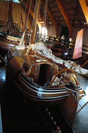 """Merlin Minshall - Enkhuizen Netherlands Zuiderzee museum ships hall with the """"boeier"""" Sperwer (Eurasian sparrowhawk) once owned by Merlin Minshall"""