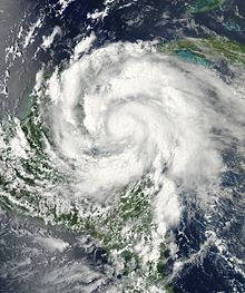 Satellite imagery depicting an intensifying hurricane in the Caribbean Sea