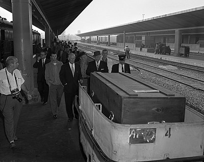 Errol Flynn's coffin on Los Angeles Union Station train platform, California, 1959.jpg