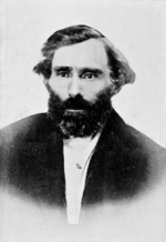 black-and-white photo of Eugene Skinner, a bearded man