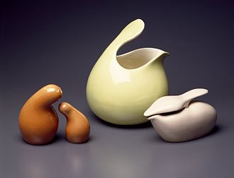 "Eva Zeisel - Some of Zeisel's ceramic pieces designed for Red Wing Pottery's ""Town and Country"" dinner service (ca. 1940s). These pieces, including a salt and pepper shaker set and a baby oil pourer, exemplify her organic, curving forms."