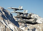 F-35Cs of VFA-101 in flight with FA-18EFs of VFA-122 in April 2015.JPG