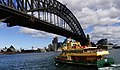 Ferry under the Bridge.Sydney. (21129711798).jpg
