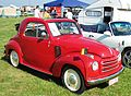 Fiat 500C Topolino ca 1950 with flags.jpg