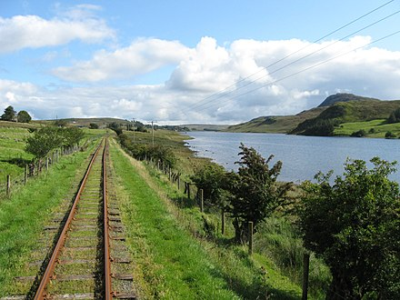 Fintown Railway on the track of County Donegal Railways Joint Committee next to Lough Finn near Fintown railway station. Fintown Railway on trackbed of CDR County Donegal Railway, Lough Finn (5951398952).jpg