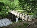 Footbridge near weir on the shore of Grasmere - geograph.org.uk - 1299277.jpg