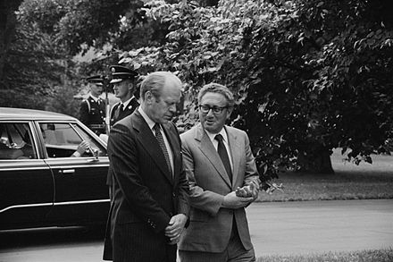 Ford and Kissinger conversing on the White House grounds, August 1974 Ford and Kissinger conversing, on grounds of White House, 16 Aug 1974.jpg