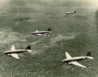913th Air Refueling Squadron - C-47s flying supplies to a forward airfield in New Guinea escorted by P-40s