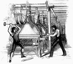 Picture of Luddites smashing a loom with a sledge hammer