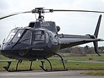 G-OGUN Eurocopter AS350B2 Ecureuil Helicopter (R and J Helicopters LLP) (46273621765).jpg