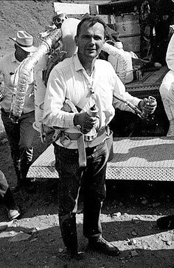 Eugene Shoemaker wearing a Bell rocket belt while training astronauts.