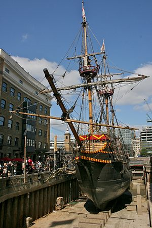 Golden Hinde (1973) - Replica's front view, cramped in between tall buildings in a small dock on the River Thames