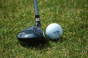 Fairway wood positioned near golf ball