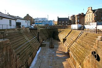 Whaling in Scotland - Graving dock, North Harbour at Peterhead. The fine, granite-built, graving dock (dry dock) was built in 1855 to meet the needs of the large Greenland whaling ships. Today it is used for the repair of fishing vessels.