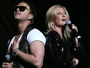 "A Celebration in Song - Guy Sebastian and Olivia Newton-John performing ""Summer Nights"" at the concert."