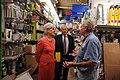 HHS Secretary Sebelius speaks with General Manager of Frager's Hardware Store during a brief tour of the facility.jpg
