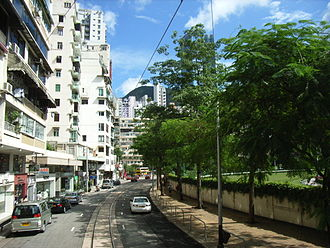 Wong Nai Chung Road - Wong Nai Chung Road, the next station is HK Tram Happy Valley Station. A portion of Happy Valley Racecourse is visible on the right.