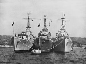 HMAS Warramunga (D123), HMCS Nootka (DDE 213) and HMS Cockade (D34) at anchor, in 1951 (NH 97046).jpg