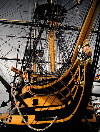 HMS Victory, Nelson's flagship at Trafalgar, is still a commissioned Royal Navy ship, although she is now permanently kept in dry-dock HMS Victory - bow.jpg
