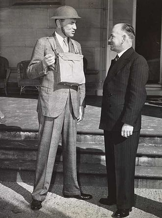 Bob Heffron - Heffron (right) with Governor Lord Wakehurst, discussing air-raid safety measures following the implementation of the National Emergency Act 1941.