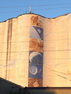 The Harvest States grain elevator with a mural on its west side.