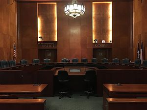 "Houston City Council - Houston City Council Chambers on the second floor of the Houston City Hall. Note the Art Deco style chandelier and words ""Justice"" and ""Counsel"""