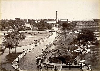 Hyderabad - A mill with a canal connecting to Hussain Sagar lake. Following the introduction of railways in the 1880s, factories were built around the lake.