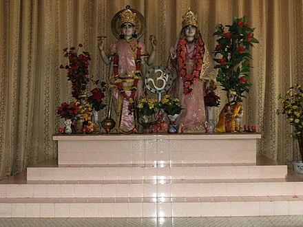Lakshmi with Vishnu in Paramaribo Hindu temple, Suriname. - Lakshmi