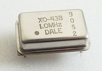 Electronic oscillator - 1 MHz electronic oscillator circuit which uses the resonant properties of an internal quartz crystal to control the frequency.  Provides the clock signal for digital devices such as computers.