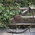 Iron wheel as beer garden ornament at Ashfold Crossways, in Lower Beeding, West Sussex.jpg