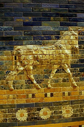 Ishtar Gate - An auroch above a flower ribbon; missing tiles are replaced
