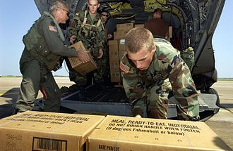 Meal, Ready-to-Eat - U.S. Army soldiers load MREs onto a CH-47 Chinook helicopter in September 2005.