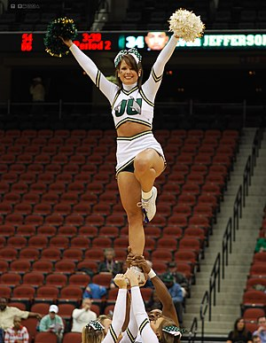 Jacksonville University - Dolphins cheerleaders performing a liberty stunt