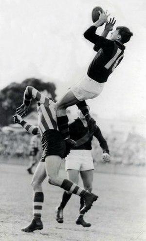 John Coleman (Australian footballer) - Coleman takes a spectacular mark in 1951.